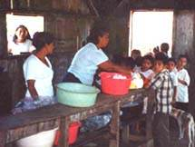 Children stand in line for food in Nicaragua - Click for more information